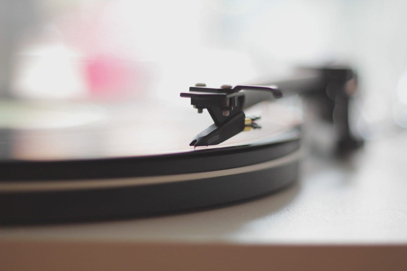 A Vinyl Record Player Stylus Up Close as it Begins to Play a Record.
