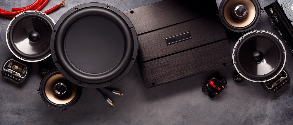 A Collection of Car Speakers, Components, and an Amplifier