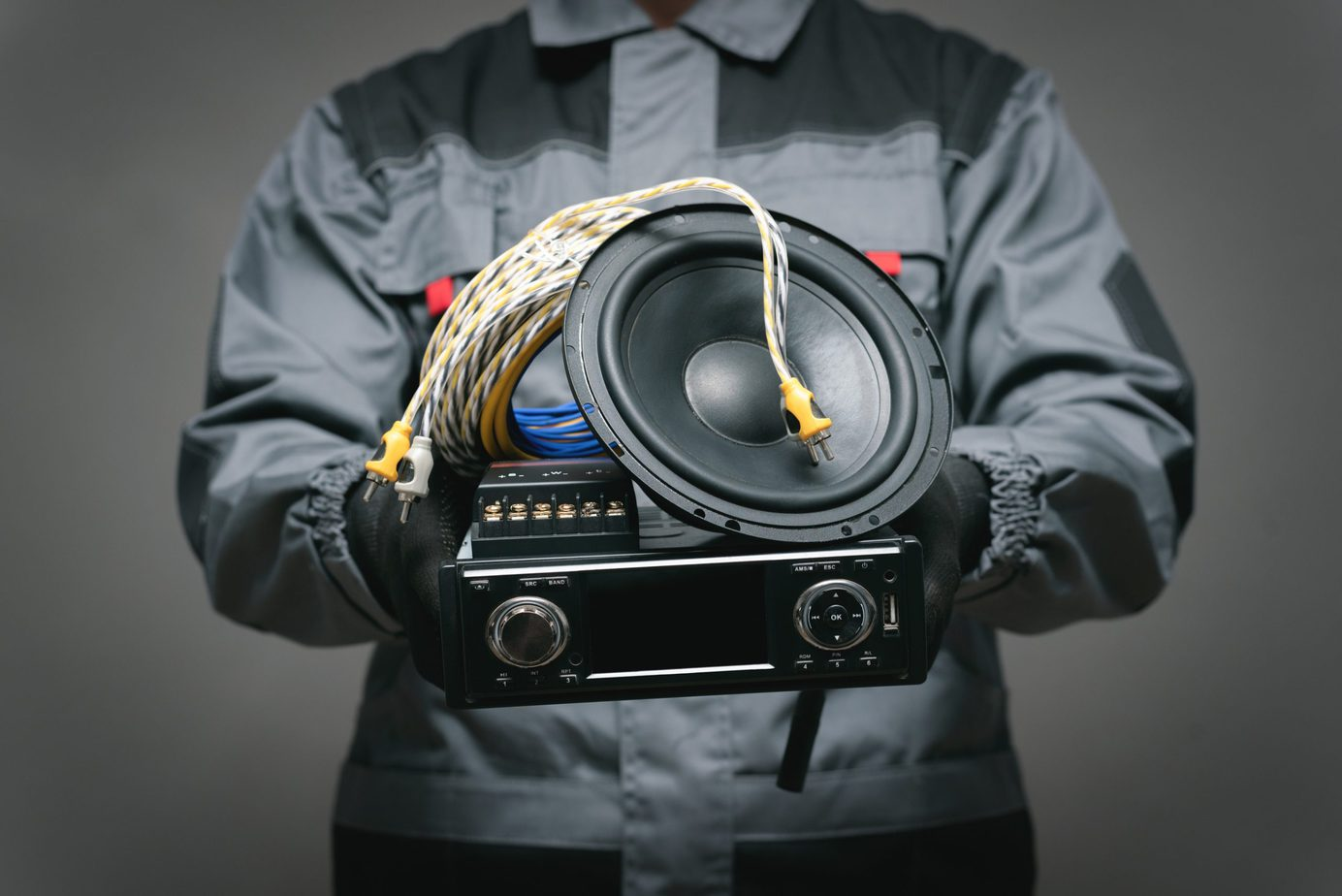 man holding subwoofer car stereo