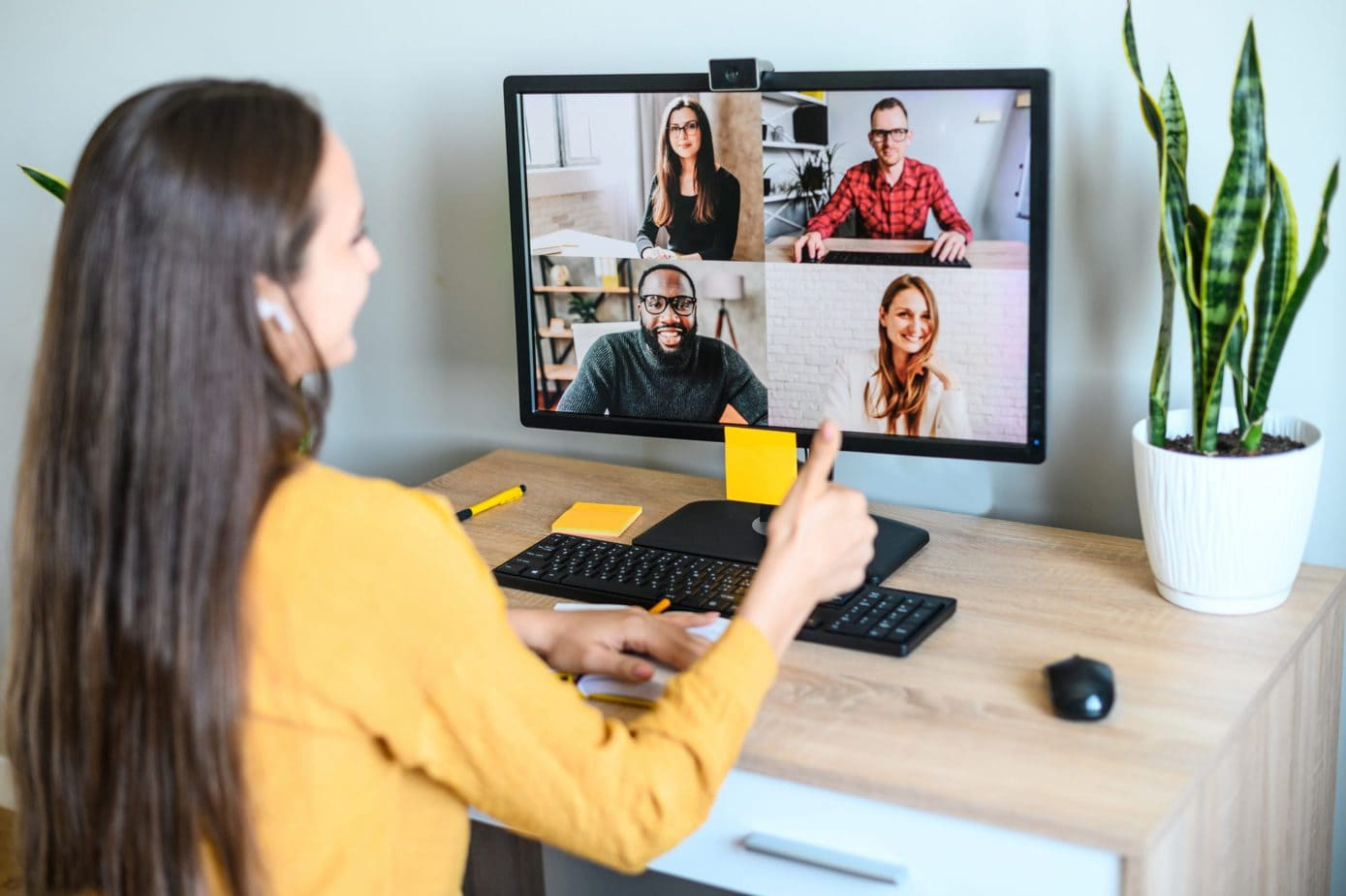 Video call young woman talks via video on PC